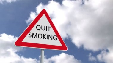 Quit smoking sign against sky — Stock Video