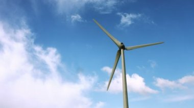 Wind energy spinning against a blue sky — Stock Video