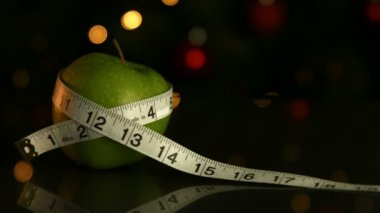Apple wrapped in measuring tape — Stock Video