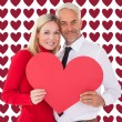 Man getting heart card form wife — Stock Photo #64816147