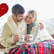 Loving couple in winter wear with cups agains — Stock Photo #64816297