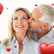 Affectionate man kissing his wife — Stock Photo #64816523