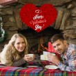 Couple with tea cups in front of lit fireplace — Stock Photo #64816855