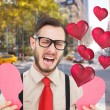 Geeky hipster crying and holding broken heart — Stock Photo #64817877