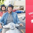 Mature couple riding a scooter — Stock Photo #64818011