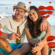 Smiling couple embracing while having a drink — Stock Photo #64818057