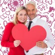 Man getting heart card form wife — Stock Photo #64818195