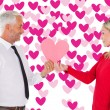 Man getting heart card form wife — Stock Photo #64818557