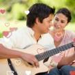 Man playing the guitar while his friend watch — Stockfoto #64818839