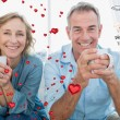 Smiling middle aged couple sitting — Stock Photo #64818933