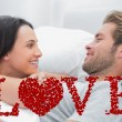 Cheerful couple awaking and looking — Stock Photo #64818985