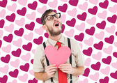 Hipster crying and holding heart card — Stock Photo