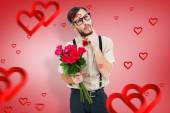 Geeky hipster offering bunch of roses — Stock Photo