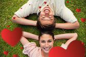 Two friends smiling while lying head to head — Stock Photo