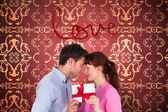 Loving couple holding a gift — Stock Photo