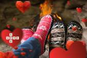 Composite image of close up of romantic legs in socks in front o — Stock Photo