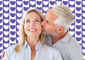 Affectionate man kissing wife on cheek — Stock Photo