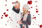 Couple in winter fashion embracing — Stock Photo