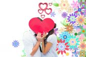 Couple covering their kiss with a heart — Stock Photo
