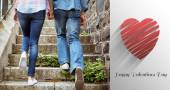 Hip young couple walking up steps — Foto Stock