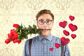 Composite image of geeky hipster biting a bunch of roses — Stock Photo