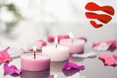 Lighted candles and petals — Stock Photo