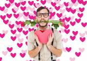Geeky hipster offering valentines gifts — Stock Photo