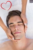 Man receiving facial massage at spa center — Stock Photo