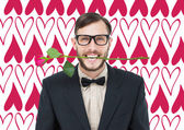 Hipster holding rose between teeth — Stockfoto