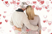 Happy couple standing with arms around — Stock Photo