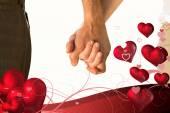 Imagen compuesta de la feliz pareja senior cogidos de la mano — Foto de Stock