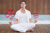 Handsome man in white meditating — Stock Photo