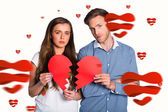 Couple holding broken heart — Stock Photo