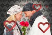 Smiling couple in winter fashion posing — Stockfoto