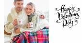 Couple in winter clothing with coffee cups — Stock Photo
