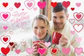 Loving couple in winter clothing with coffee — Stock Photo