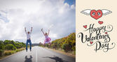 Excited couple jumping on the road — Foto Stock