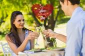 Couple toasting champagne flutes at an outdoor — Stock Photo