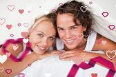 Couple under a duvet — Stock Photo