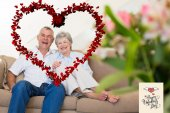 Happy senior couple relaxing on sofa — Stock Photo