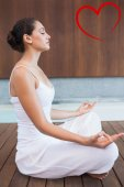 Brunette in white sitting in lotus pose — Stock Photo