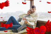 Couple in winter clothing sitting — Stock Photo