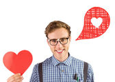 Geeky hipster holding heart card — Stock Photo