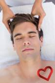 Man receiving head massage at spa center — Stock Photo