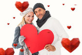 Smiling couple with heart shape — Stock fotografie