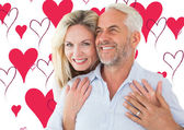 Smiling couple embracing with woman — Foto de Stock