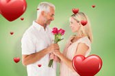 Affectionate man offering his partner roses — Stock Photo