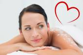 Peaceful brunette lying with salt scrub — Stock Photo