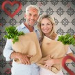 Happy couple carrying paper grocery bags — Stock Photo #64823679