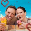 Couple drinking cocktails in the swimming pool — Stock Photo #64820211